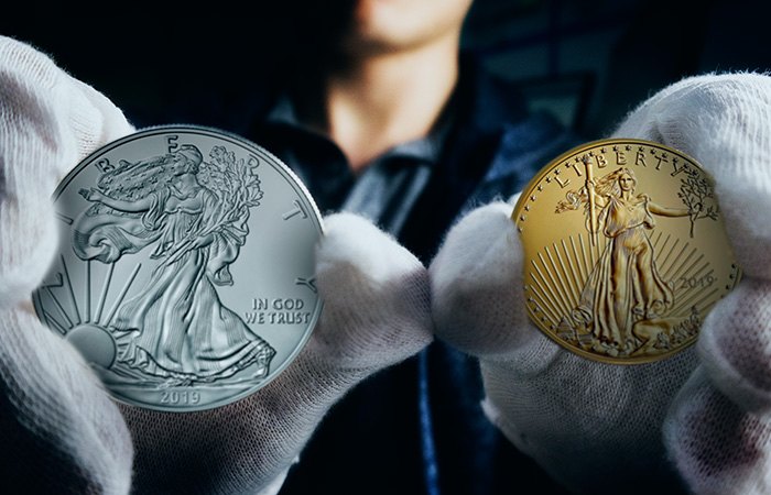 Gold and Silver Eagle Comparison In Hand